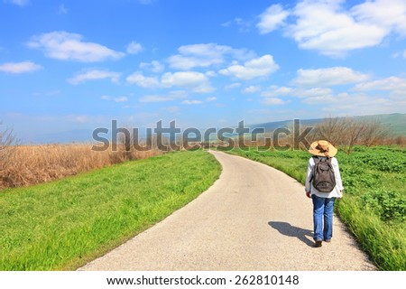 Beautiful spring landscape and hiking woman - stock photo