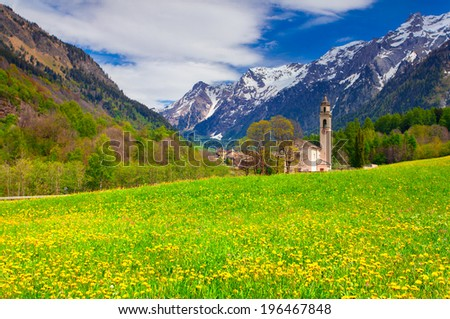 Beautiful spring landscape with church in Borgonovo village in the Swiss Alps. - stock photo