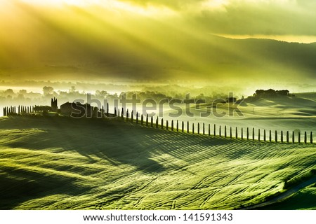 Beautiful spring sunrise over the valley of San Quirico d'Orcia