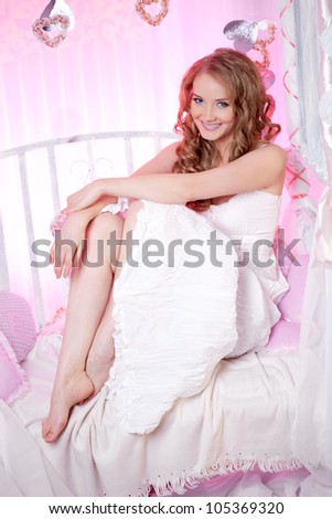 Beautiful spring woman on a pink background