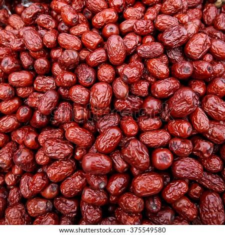 Beautiful square background pattern of jujube fruits - stock photo