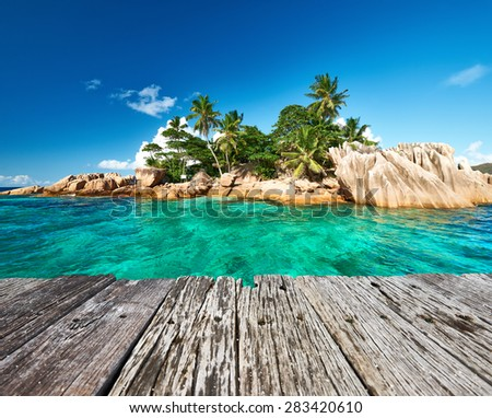 Beautiful St. Pierre Island and old wooden pier at Seychelles