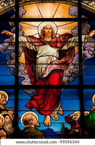 Beautiful stained glass window depicting the resurrection of Jesus, celebrated on Easter Sunday. - stock photo