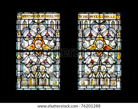 Beautiful Stained glass windows showing biblical scenes  in a Catholic Church - stock photo