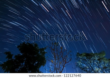 Beautiful star trail image during the night of the Geminids meteor shower in the Winter of 2012 in the Thailand - stock photo