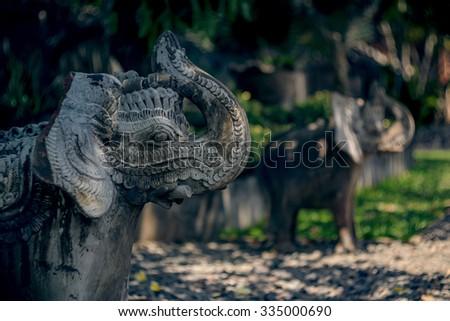 Beautiful statues of elephants on Bali island. Stone carving. - stock photo
