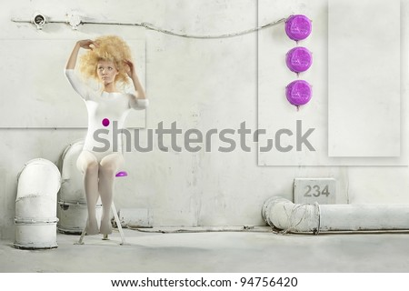 Beautiful steampunk clone blonde lady in industrial interiors - stock photo