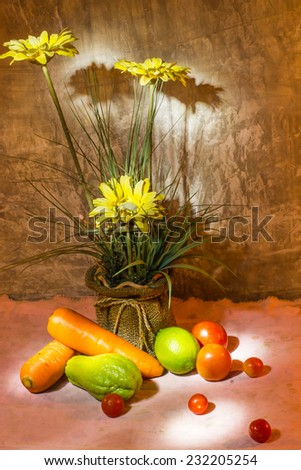 Beautiful still life with flowers and organic vegetables and fruit - stock photo