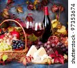 Beautiful still life with wine glasses, grapes, pomegranate and cheese - stock