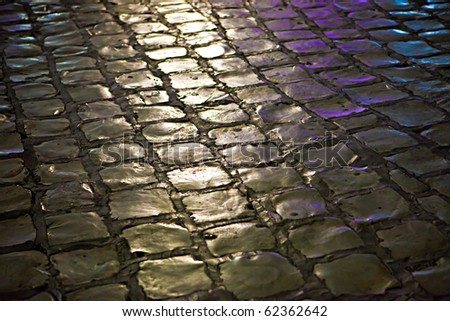Beautiful stone roadway at night - stock photo
