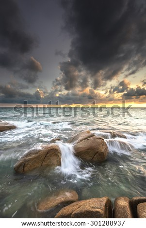 beautiful stone sun storm and wave