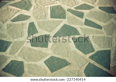 Beautiful stone walkway in vintage colour tone background. - stock photo