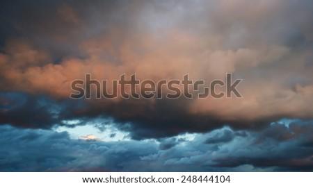 Beautiful storm clouds at sunset. - stock photo