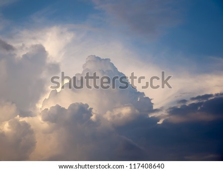 Beautiful stormy cumulus clouds in the sky. Background. - stock photo