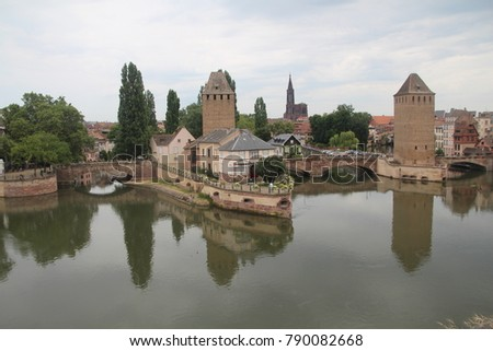 Beautiful Strasbourg, Alsace, France. Medieval towers and bridges, les Ponts Couverts with mirror reflection. Summer vacation