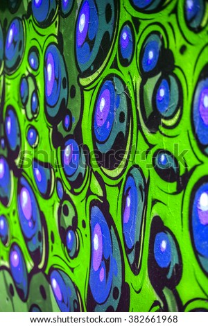 Beautiful street art of graffiti. Abstract color creative drawing fashion on walls of city. Urban contemporary culture. Original dot pattern with selective focus in the future. Creative design option