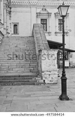 beautiful street lamp next to a stone staircase black and white