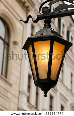 Beautiful street lanterns illuminated at evening. Riga. Latvia - stock photo
