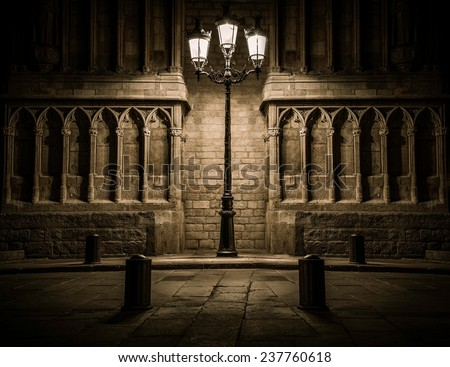 Beautiful streetlight in front of old building in Barcelona - stock photo