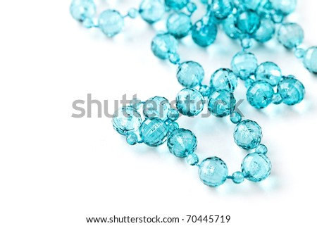 Beautiful string of beads, necklace isolated on white - stock photo
