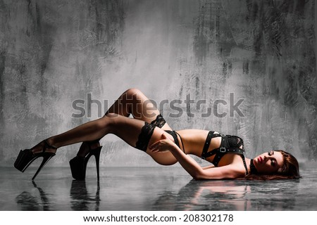 beautiful striptease dancer posing on studio background - stock photo
