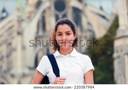 Beautiful student girl in the city - stock photo