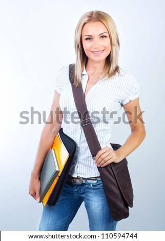 Beautiful student girl isolated on white background, smart pretty teenager female holding textbooks, back to school, cute schoolgirl with laptop bag, knowledge and education concept - stock photo