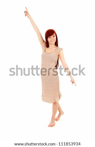 beautiful student girl pointing up and down, full length, white background - stock photo