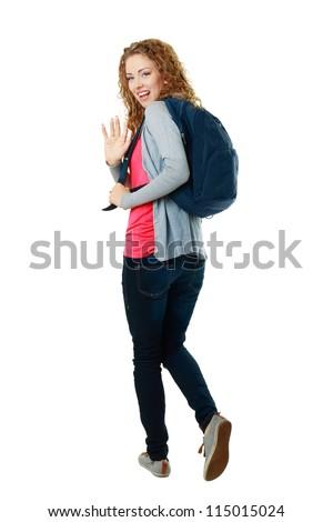 beautiful student girl walking away and saying bye-bye - stock photo