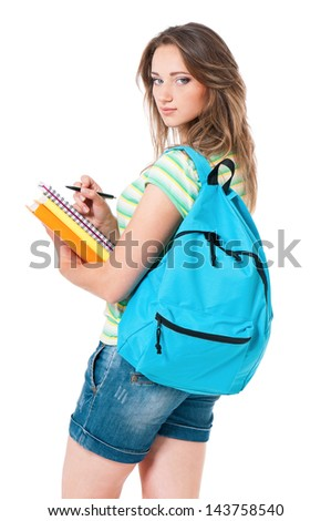 Beautiful student girl with backpack and books, isolated on white background - stock photo