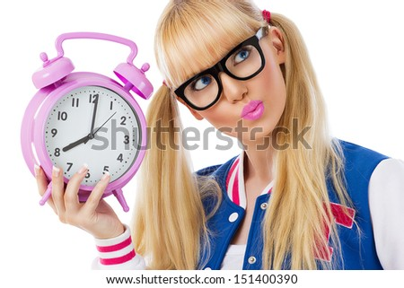 Beautiful student girl with clock on white background - stock photo