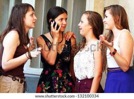 Beautiful student girls during phone call - stock photo