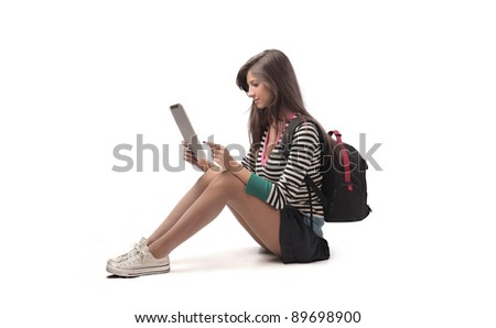 Beautiful student using a tablet pc