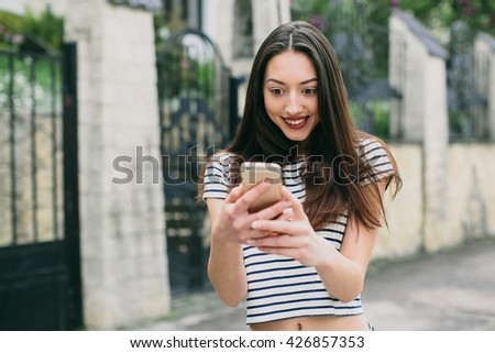 Beautiful stylish and fashionable girl calling and sms received.