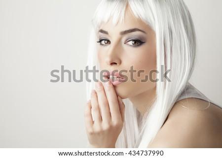 beautiful stylish blond hair woman, studio portrait white background - stock photo
