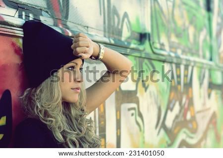 Beautiful stylish blonde girl in black cap - stock photo