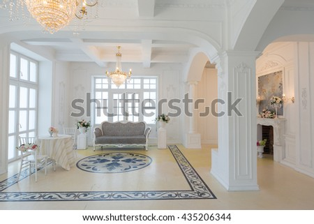 beautiful stylish chic rich clean bright blank interior. high white walls with large windows from floor the pattern on the floor