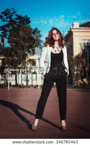 Beautiful stylish girl with strong look on a playground