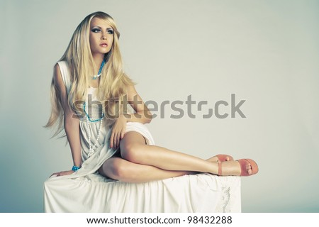 Beautiful stylish lady sitting in a trendy shoes - stock photo