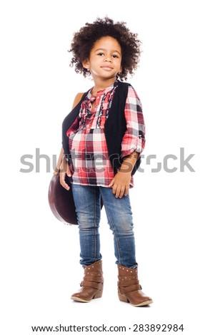 Beautiful stylish little girl with folk leather bag - stock photo