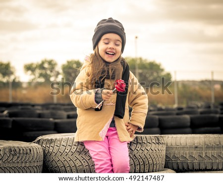 beautiful stylish little girl with glasses on the background of the racing tracks, emotions, girls, large inflated lips in the form of candy