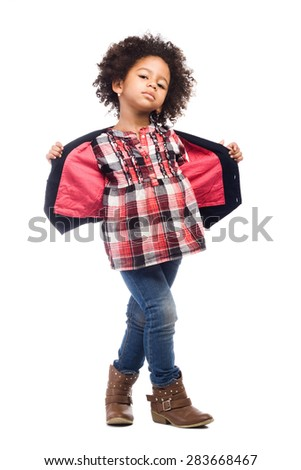 Beautiful stylish little girl with leather bag