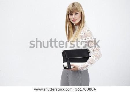 Beautiful stylish model with leather handbag, portrait - stock photo