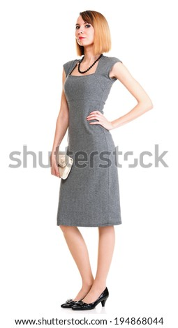 Beautiful stylish woman in elegant grey dress isolated white - stock photo