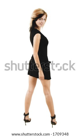 Beautiful stylish woman posing in a cute black dress - isolated on white - very high resolution - stock photo