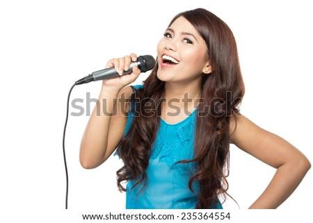 beautiful stylish woman singing karaoke isolated over white background - stock photo