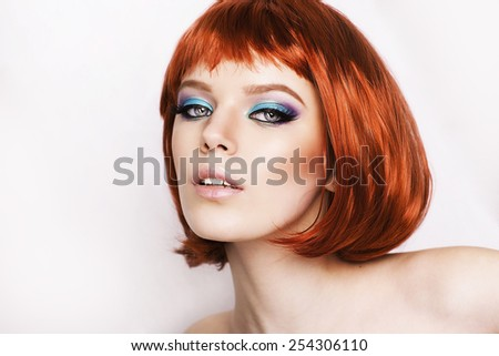 Beautiful stylish woman with red hair on white background. Bob haircut. Red hair. Professional make up. Colorful hair. Healthy shiny hair. Portrait of woman. Beautiful model.  Studio portrait