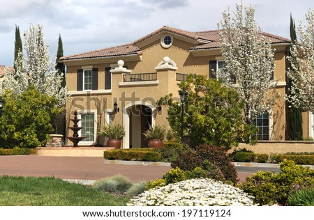 Beautiful suburban home during spring - stock photo