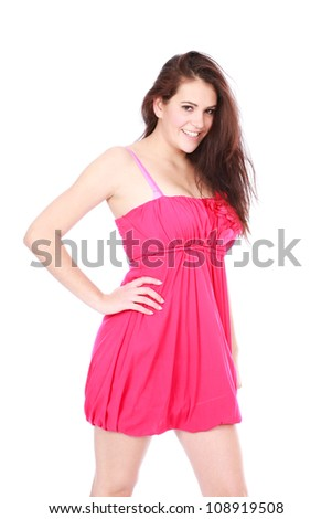 Beautiful sultry sexy brunette woman wearing pink mini skirt dress posing for camera on white isolated background - stock photo