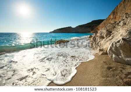 Beautiful summer coast Porto Katsiki beach on Ionian Sea (Lefkada, Greece) with sun in sky and wave